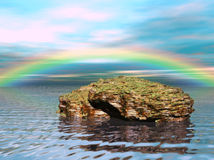 Dreamy Waters 1. A digitally created image of a beautiful rock in the ocean with a rainbow in the background Royalty Free Stock Photo
