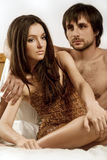 Dreamy woman. And man in the bedroom Stock Photography