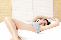 Dreamy woman on bed Royalty Free Stock Photo