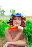 Dreamy woman with bunch of carrots Royalty Free Stock Photography