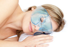 Dreamy woman with an eye gel mask Royalty Free Stock Photography