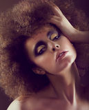 Dreamy Woman with Frizzy Hairstyle and Golden Eyeshadow Royalty Free Stock Images