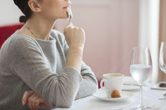 Dreamy woman having coffee Royalty Free Stock Photography