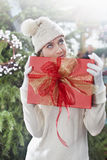 Dreamy woman, holding her christmas gift Royalty Free Stock Photo