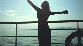Dreamy woman near lifebelt enjoying amazing seascape in slow motion, blurred sunny reflection on the sea. 1920x1080