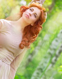 Dreamy woman in the park Royalty Free Stock Image