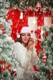 Dreamy woman on snowfall background Christmas tree Royalty Free Stock Image