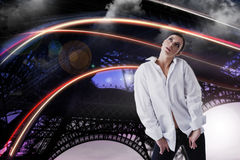 Dreamy woman in white shirt looking up over fantastic abstract background Royalty Free Stock Images