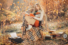Dreamy woman writing in the autumn park Royalty Free Stock Photo