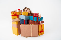 Dreamy young beautiful curly girl among gift boxes Isolated Stock Photo