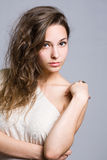 Dreamy young brunette beauty. Royalty Free Stock Photo