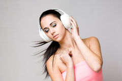 Dreamy young brunette enjoying music. Stock Photo