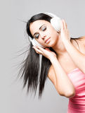 Dreamy young brunette enjoying music. Royalty Free Stock Image