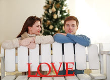 Dreamy young couple in love in studio at home Royalty Free Stock Photo