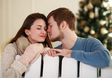 Dreamy young couple in love in studio at home Royalty Free Stock Photography