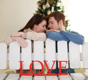 Dreamy young couple in love in studio at home. Dreamy young couple in love in the studio at home Stock Photography