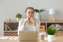 Dreamy girl looking aside thinking of future success