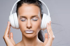 Dreamy young music lover. Stock Image