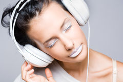 Dreamy young music lover. Royalty Free Stock Photos