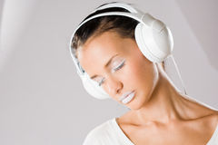 Dreamy young music lover. Royalty Free Stock Photo