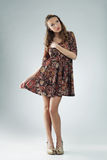 Dreamy young woman. Beautiful romantic young woman wearing floral dress Royalty Free Stock Photo