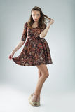 Dreamy young woman. Beautiful romantic young woman wearing floral dress Stock Photos