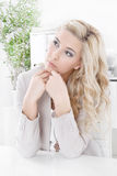 Dreamy young woman in the job - Daydreams. Dreamy blond woman in job Royalty Free Stock Photography