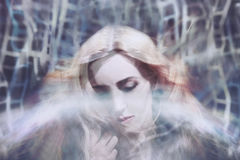 Dreamy young woman. Dreamy portrait of a beautiful young woman Royalty Free Stock Images