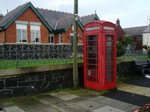 Dreary Phonebooth. A British Phone booth set on a street in a country town Stock Photo