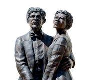 Dred斯科特和妻子在白色背景的哈丽鲁宾逊雕象 免版税库存照片