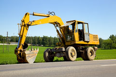Dredge. The yellow dredge standing on road Royalty Free Stock Photo