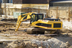 Dredge. A yellow dredger excavating ground on a construction site Stock Photography