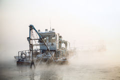 Dredge boat in the fog Royalty Free Stock Photography