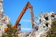 The dredge destroys an old building Royalty Free Stock Photo