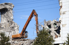 Dredge destroys an old building Royalty Free Stock Photo