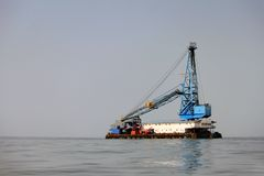 Dredge. The dredge floats by sea royalty free stock images