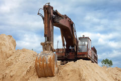 Dredge on a heap of sand Royalty Free Stock Images