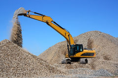 Dredge Loads A Rubble Royalty Free Stock Photos