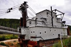 Dredge No. 4 near Dawson City, Yukon. Dredge No. 4 stands 18 meters high amid the rough and rugged Klondike Gold Fields stock image