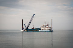 Dredge pumping sand at sea Royalty Free Stock Photography