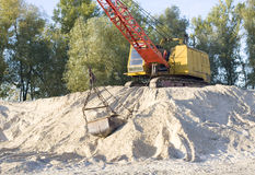 Dredge on sand. Picture of excavator working with sand Stock Images