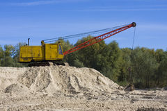 Dredge on sand. Picture of excavator working with sand Stock Photography