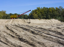 Dredge on sand. Picture of excavator working with sand Stock Photos