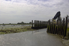 The dredged deep water channel and quayside at Bosham Harbour in West Sussex England Royalty Free Stock Photography