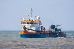 Dredger. A dutch Dredger at zea stock images