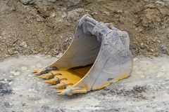 Dredger bucket. Old dredger bucket on loamy ground Royalty Free Stock Photos