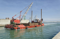 Dredger coming into port Royalty Free Stock Images