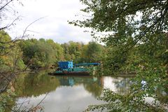 The dredger. Deepens the river bed in the mainstream Stock Photo