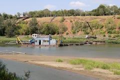 Dredger. Dredging on the river Stock Photo