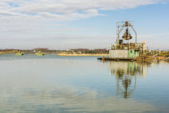 Dredger in the gravel pit water. Stock Images